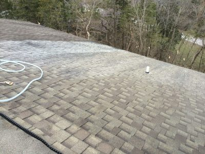 During a professional roof washing service.